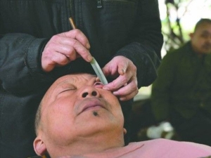 Chinese Barbers Known For Their Skill Of Eyeball Shaving